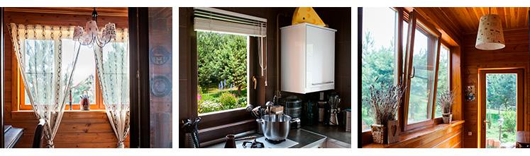 Окна из дерева дополняют интерьер загородного дома